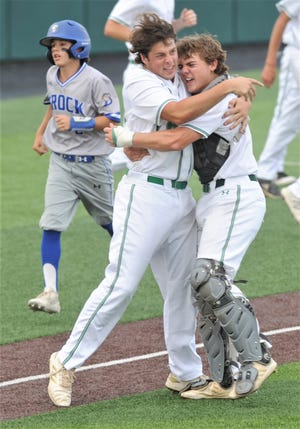 Wall catcher Tanner Seider, right, celebrates with Trace Briley after the Hawks beat Brock 20-1 in five innings in Game 3 to win the Region I-3A championship series Friday, May 31, 2019, at Abilene Christian University's Crutcher Scott Field.