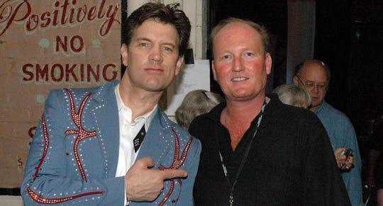 Jeffrey Burton, right, with Chris Isaak.