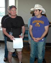 Jeffrey Burton, left, with Brad Paisley.
