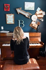 Ashley Ballous-Bonnema plays the piano in her home music studio Friday, May 31, in Sioux Falls.