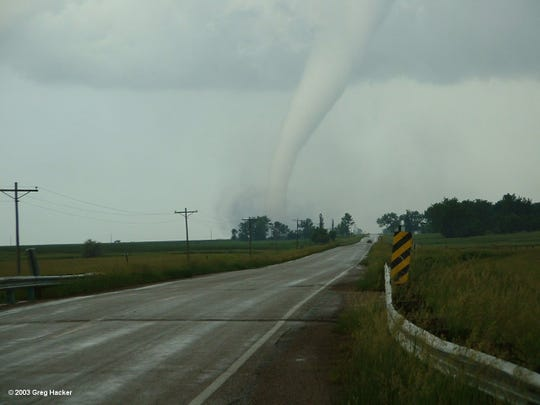 A tornado spins near Manchester on June 24, 2003.