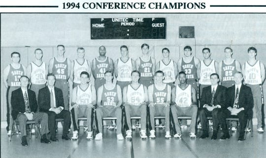 The 1993-94 South Dakota Coyotes men's basketball team. Nick Nurse is seated on the front right.