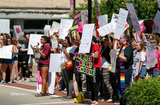People lined Park Central Square in downtown Springfield to protest Missouri's new abortion law that bans abortions at or beyond the eighth week of pregnancy on Friday, May 31, 2019.