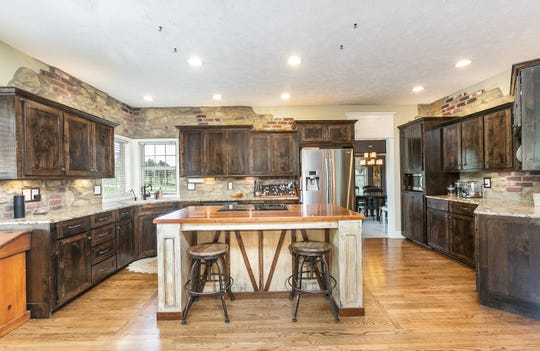 The kitchen is open to a family living area as well as the formal dining room.