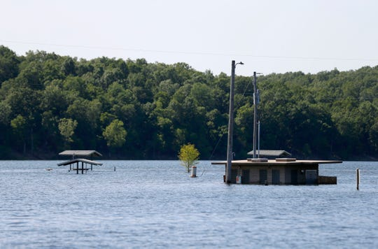 Pavilions and a bathroom surrounded by water at Bull Shoals Lake on Friday, May 31, 2019.