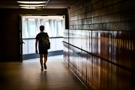 A student walks past lockers on the last day of school Friday, May 31, at Tech High School in St. Cloud.