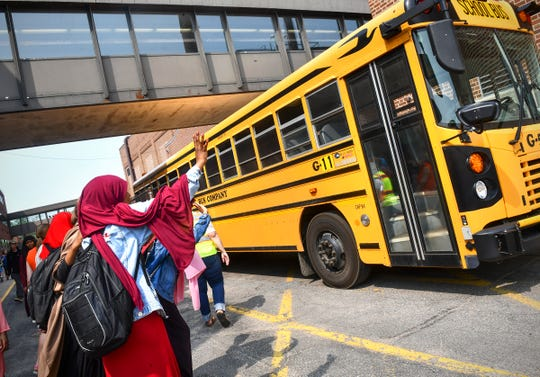 Students wave goodbye to friends during the last day of school at Tech High School Friday, May 31, In St. Cloud.