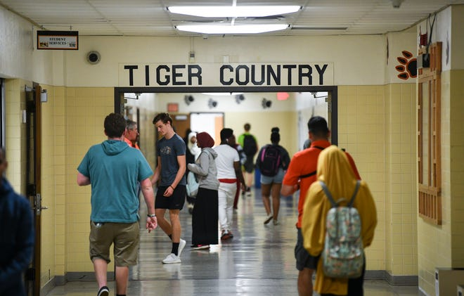 Students move between classes during the last day of school at Tech High School Friday, May 31, In St. Cloud.