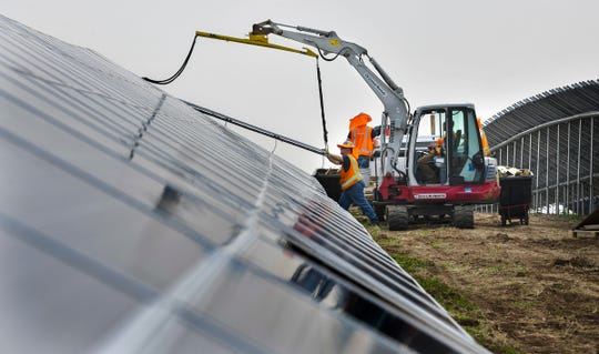 New panels are put into place Thursday, May 30, in a new solar garden along Sherburne County Road 8 south and east of St. Cloud.