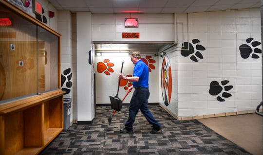 Bob Henkemeyer keeps the hallways clean during the last day of school at Tech High School Friday, May 31, In St. Cloud. The school opened in 1917. Students will attend classes in a newly constructed building in the fall.