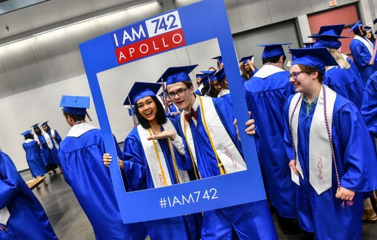 Students pose for a photo during the Apollo High School graduation ceremony Thursday, May 30, at the River's Edge Convention Center in St. Cloud.