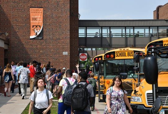 Students line up in the bus chute during the last day of school at Tech High School Friday, May 31, In St. Cloud.