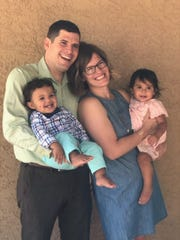 Susanne and Martin with their newly adopted children, Martin and Maddie.