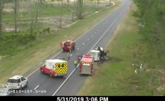 A traffic camera view of what appears to be a vehicle fire that is causing gridlock on I-10 Westbound in Jackson County near mile marker 157