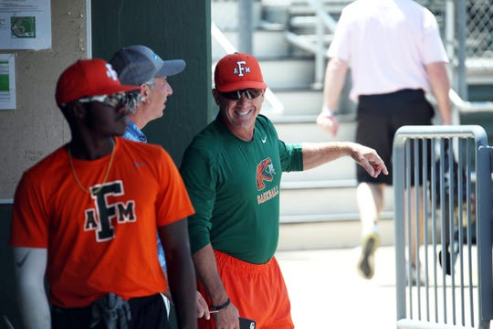 FAMU baseball head coach Jamey Shouppe shares a laugh in the dugout during practice at Georgia Tech on Thursday, May 30, 2019.