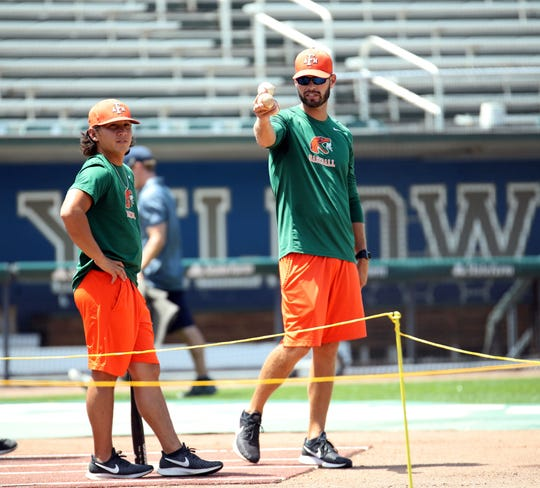 FAMU pitching coach Bryan Henry (right) and volunteer assistant Alec Wong look over the action during practice at Georgia Tech on Wednesday, May 30, 2019.