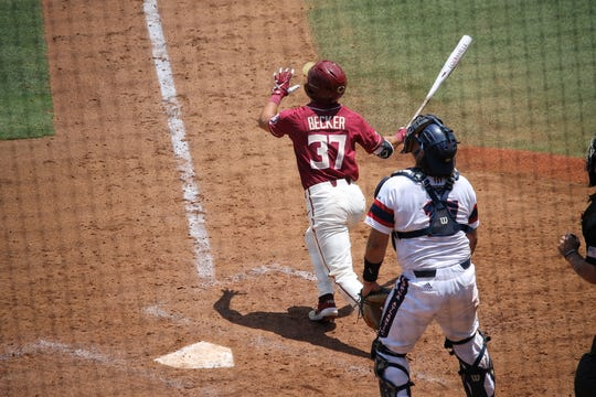 Tim Becker hits a homerun during FSU baseball's NCAA regional game against Florida Atlantic
