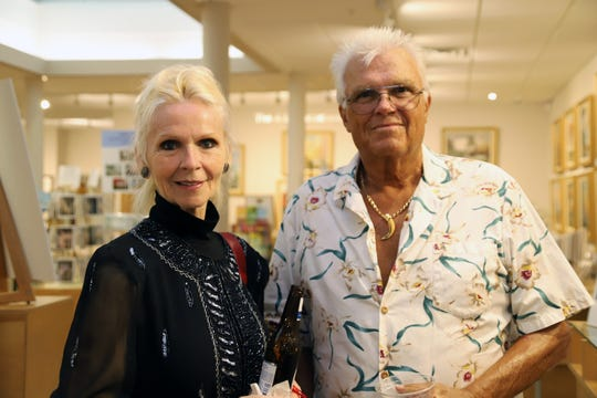 "Maria Young, left, and Skip Bursh at the A.E. Backus Museum and Gallery for the ""Through the Eye of the Camera"" exhibition opening May 17."