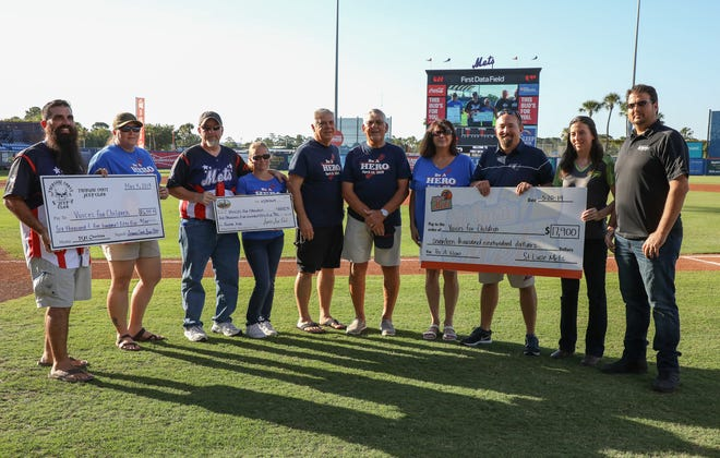 Pictured, from left, Treasure Coast Jeep Club members Jameson Ward and Rhianna Fincher holding a $6,555 check; Jupiter Jeep Club members Matt Black and MaryBeth Black holding a $6,555 check; Voices for Children representatives Bob Perry and Gary Tenpas, Jordana Hollander, with Guardian ad Litem, St. Lucie Mets' Traer Van Allen and All Roads Jeepers members Holly and Tony Henderson holding a $17,900 check.