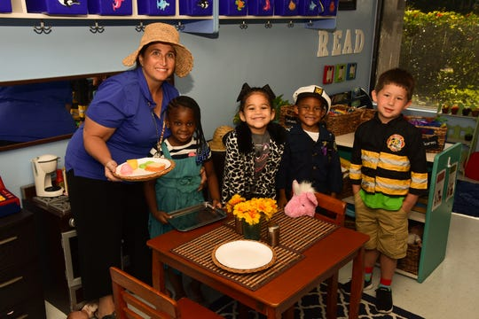 Shirley Prescott, left, with students who attend Bridges Early Learning Center at the Emerson Center.