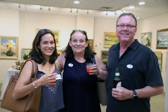 "Lauren Poole, left, and Robin and Dave Poole at the A.E. Backus Museum and Gallery for the ""Through the Eye of the Camera"" exhibition opening May 17."
