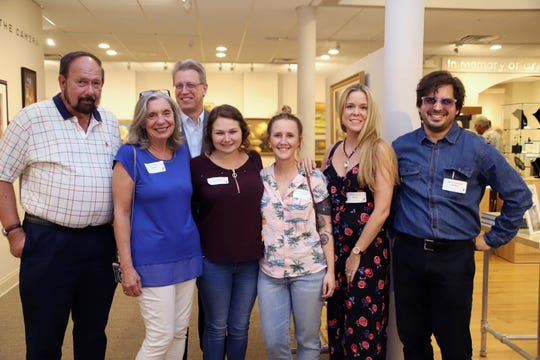 "Sponsors Jiffy Photo & Framing representatives Mike and Janie Hinkle, left, Backus Museum Executive Director J. Marshall Adams, Ginny Faitella, Samantha Byron, Ashley Hillman and Anthony Inswasty at the ""Through the Eye of the Camera"" exhibition opening May 17."
