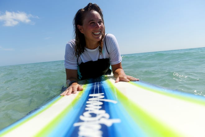 Laurie Blandford, entertainment reporter for TCPalm, waits for the right wave as she spends the morning surfing at Pepper Park Beach on North Hutchinson Island Friday, May 31, 2019, north of Fort Pierce. Blandford got into the sport after taking lessons with a friend at Pepper Park in February where she's continued to surf nearly every weekend. Pepper Park is a great beach for beginners so as not to interfere with more experienced surfers.