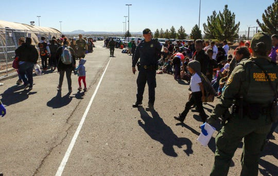 This May 29, 2019, photo released by U.S. Customs and Border Protection shows some of the 1,036 migrants who crossed the U.S.-Mexico border in El Paso, the largest that the Border Patrol says it has ever encountered. Video shows them going under a chain-link fence to the U.S., where they waited for agents to arrive. The Border Patrol has encountered 180 groups of more than 100 people since October, compared with 13 during the previous 12-month period and two the year before.