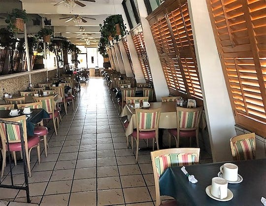 Tables are empty after Elmer's Family Restaurant, located at 6305 Montana Ave. in East-Central El Paso for 57 years, closed due to a lease dispute.