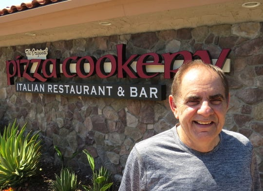 """Jordan Klempner poses in front of the newly installed sign at The Original Pizza Cookery in Thousand Oaks, where the restaurant will open June 3 after moving from Woodland Hills, where it closed on May 26. """"My No. 1 concern was to keep all my people employed,"""" Klempner says of the quick turnaround."""