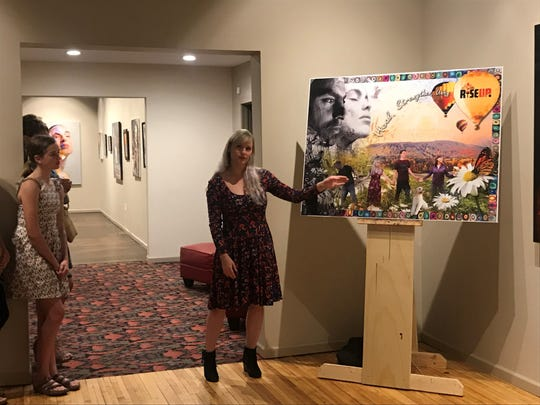 Lead artist Stefanie Sladky talks to a crowd on Thursday, May 30, 2019 about the mural design for the side of the Frontier building in downtown Wausau.
