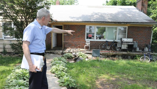 Kevin Mackey, a county health department inspector, points out violations at 25 Fairview Ave. in Spring Valley on Friday, May 31, 2019.