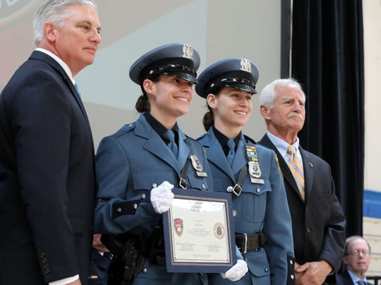 New Rochelle Police Officer Kari Bird poses for a photo with her sister, New Rochelle Police Officer Marisa Bird as well as Westchester Public Safety Commissioner Thomas Gleason, left, and New Rochelle Police Commissioner Joseph Schaller at the 147th Westchester County Police Academy graduation ceremony at Westchester Community College May 31, 2019 in Valhalla.