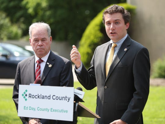 State Senator James Skoufis, right, and Rockland County Executive Ed Day, offers comments during a press conference on the county's code violations efforts outside 13-17 Cornelison Ave. in South Nyack on Friday, May 31, 2019.