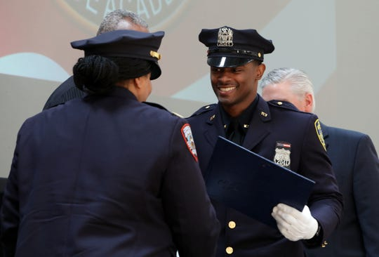 Captain Brittany Brown with the New York City Department of Corrections congratulates her cousin, Mount Vernon Police Officer Wendell Barbour, at the 147th Westchester County Police Academy graduation ceremony at Westchester Community College May 31, 2019 in Valhalla.