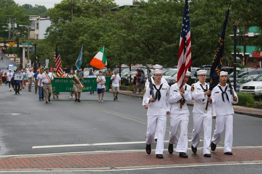 Marchers participate during the Wilmington Memorial Day parade on Delaware Avenue Thursday.