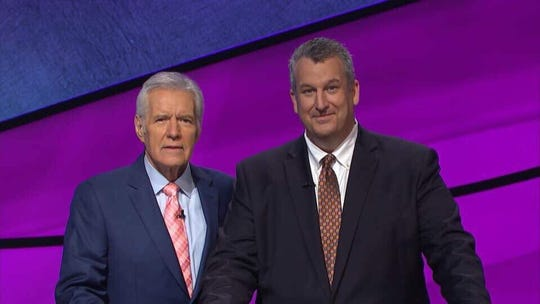 "Newark resident Rob Wolf with ""Jeopardy!"" host Alex Trebek. The physician competed on the show Thursday night."