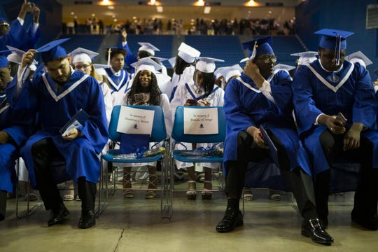 Chairs for Dametrius Benson and Brandon Wingo sit in the front row of Howard High School of Technology's graduation ceremony Thursday, May 30, 2019 at the Bob Carpenter Center. Both Wingo and Benson were killed by gunfire in Wilmington.