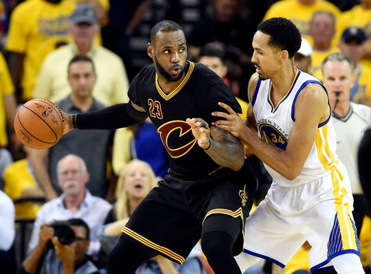 LeBron James and Shaun Livingston mix it up in Game 7 of the 2016 NBA Finals.