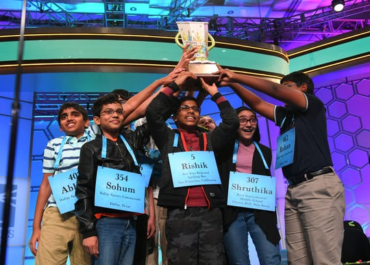 May 30, 2019; National Harbor, MD, USA; Rishik Gandhasri, Erin Howard, Saketh Sundar, Shruthika Padhy, Sohum Sukhatankar, Abhijay Kodali, Christopher Serrao and Rohan Raja are all announced as winners  during the 2019 Scripps National Spelling Bee at Gaylord National Resort and Convention Center. Mandatory Credit: Jack Gruber-USA TODAY Sports ORG XMIT: USATSI-404661 (Via OlyDrop)