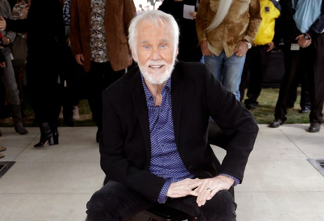 Kenny Rogers poses with his star on the Music City Walk of Fame in Nashville, Tenn. on Oct. 24, 2017.