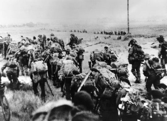 This file photo taken on June 6, 1944, shows the Allied forces soldiers landing in Normandy.