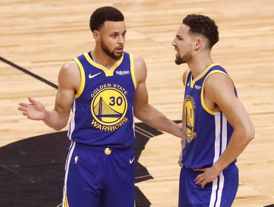 Golden State Warriors guards Stephen Curry and Klay Thompson.