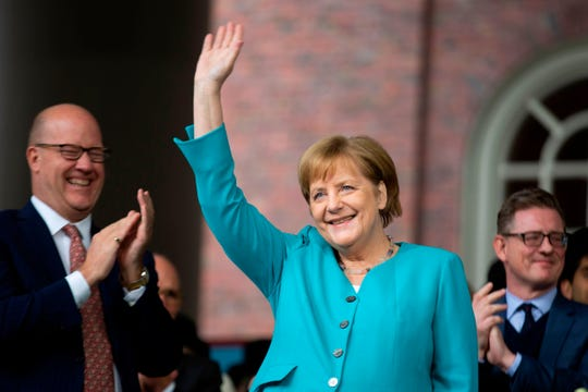 German Chancellor Angela Merkel waves before delivering the keynote speech at Harvard's 368th commencement ceremony at Harvard University in Cambridge, Massachusetts, on May 30, 2019. (Photo by Allison Dinner / AFP)ALLISON