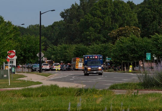Emergency vehicles respond near the intersection of Princess Anne Road and Nimmo Parkway following a shooting at the Virginia Beach Municipal Center on Friday, May 31, 2019, in Virginia Beach, Va. At least one shooter wounded multiple people at a municipal center in Virginia Beach on Friday, according to police, who said a suspect has been taken into custody.
