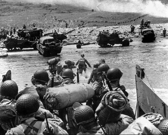American soldiers land on the French coast of Normandy during the D-Day invasion in June 1944.