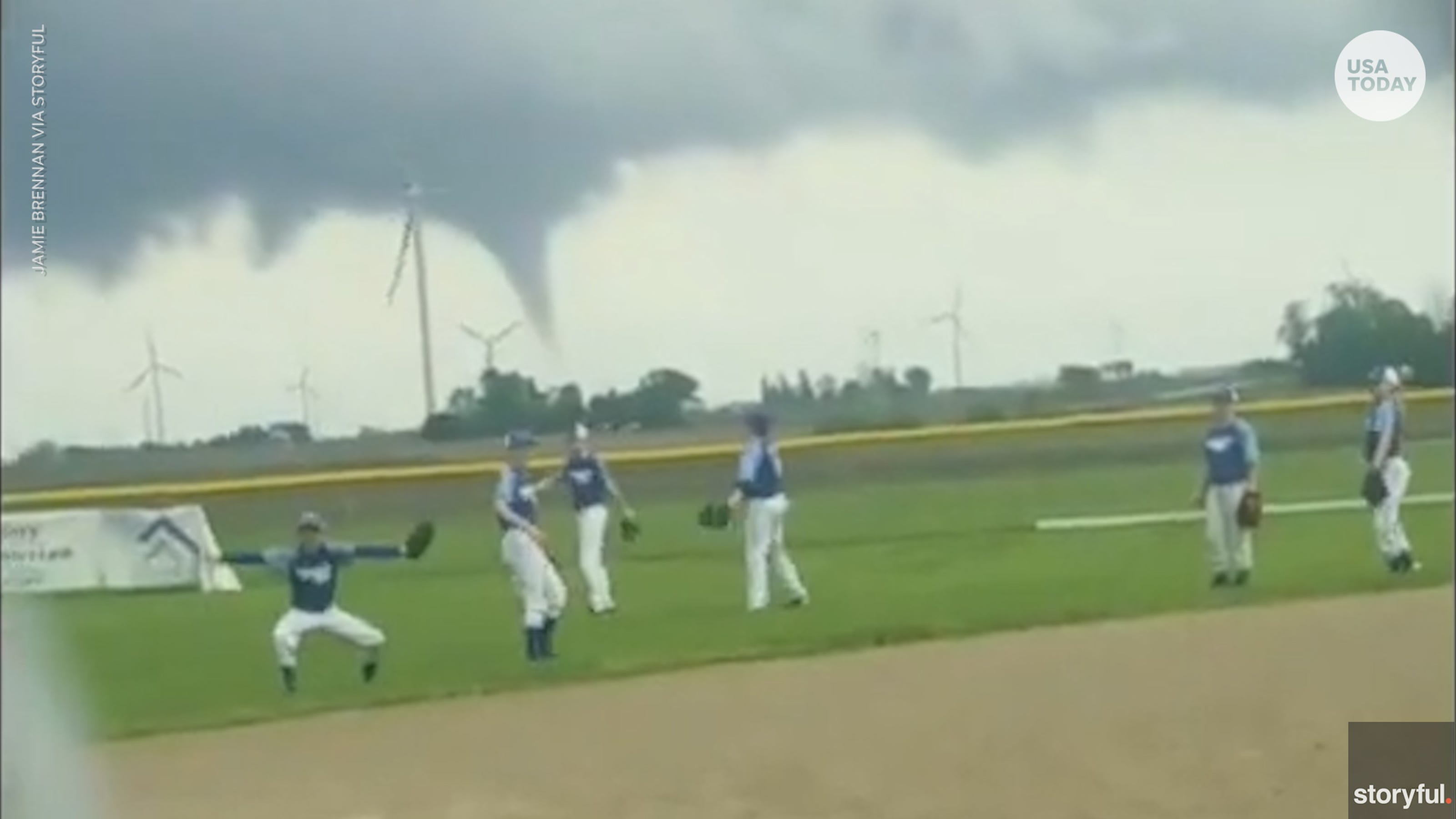 Baseball Players Keep Practicing With Apparent Tornado