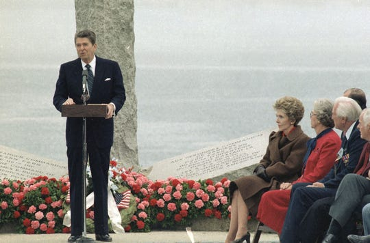 President Ronald Reagan delivers a speech at the Pointe du Hoc Memorial in Normandy, France, June 6, 1984, during commemorative ceremonies of the 40th anniversary of the Allied landing in Normandy in 1944.