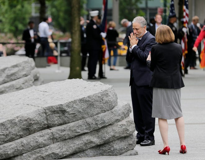 John Stewart talks with Alice Greenwald, CEO of the National September 11 Memorial & Museum, before the start of a dedication ceremony in New York, Thursday, May 30, 2019.