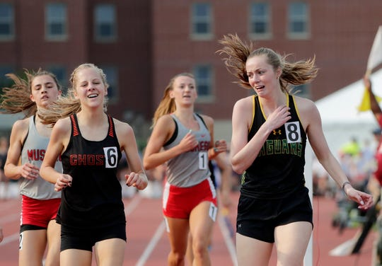 Ashwaubenon's Sage Wagner, right, and Kaukauna's Anna Fauske react after finishing second and third in the Division 1 1,600 run at the WIAA state track and field meet Friday at Veterans Memorial Field in La Crosse.